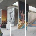 Lapsi ihastelee graffititaidetta urbaanissa ympäristössä